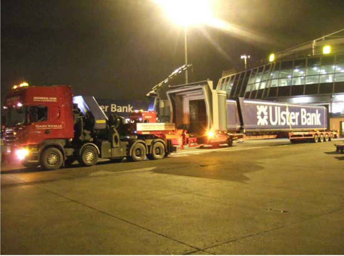 Airbridge is placed on extendable trailer for transport